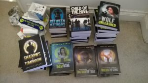 Piles of books in preparation for convention